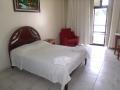 cama de casal quarto simples