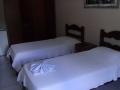 foto quarto com 3 camas